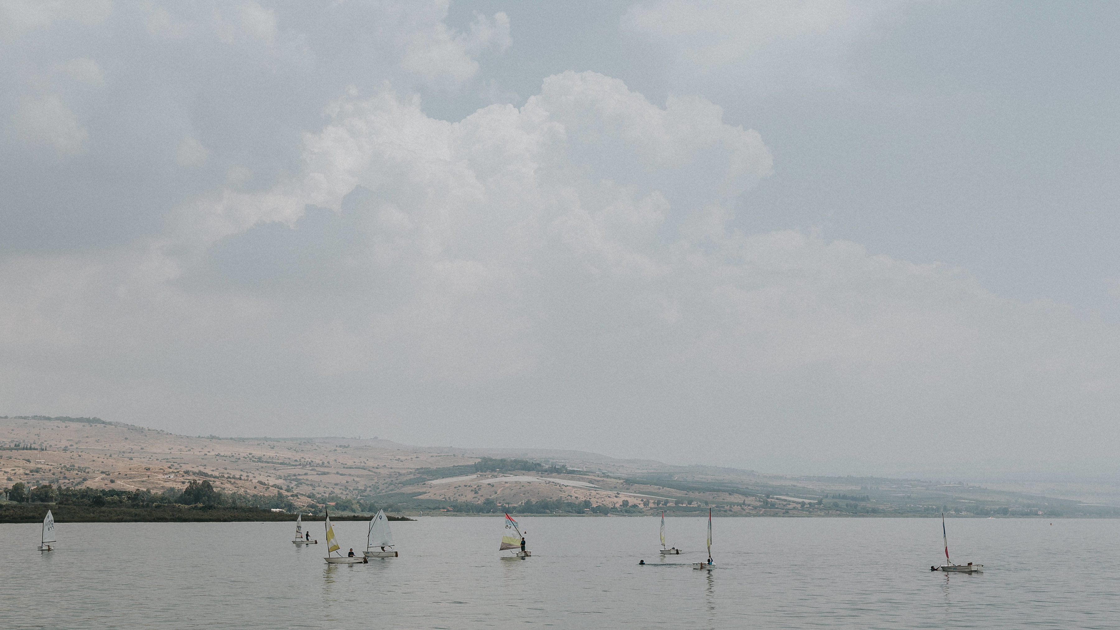 As we stepped onto our Galilean sea-cruise, we noticed these small one-man sailboats. If you look closely, it looks like a class learning to sail!